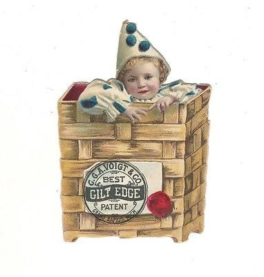 c1890-Die-Cut-Voigt-amp-Co-Grand-Rapids-Boy-Wearing-Clown-Suit-In-Basket