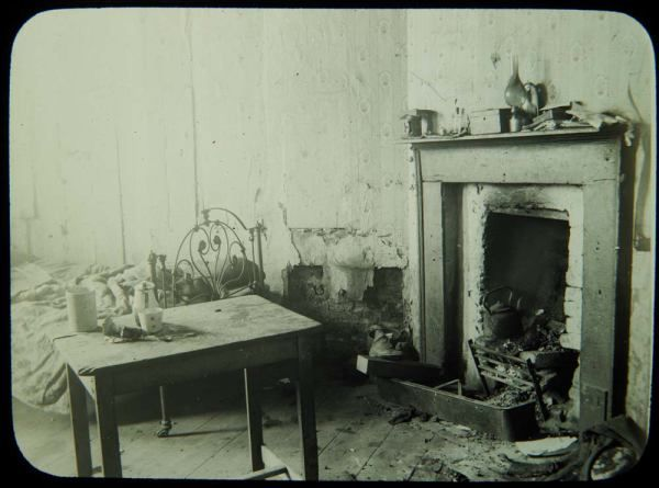 dilapidated tenement room in the Coombe Dublin area in 1913. The brutal reality of daily life for tens of thousands who lived in tenement sl...