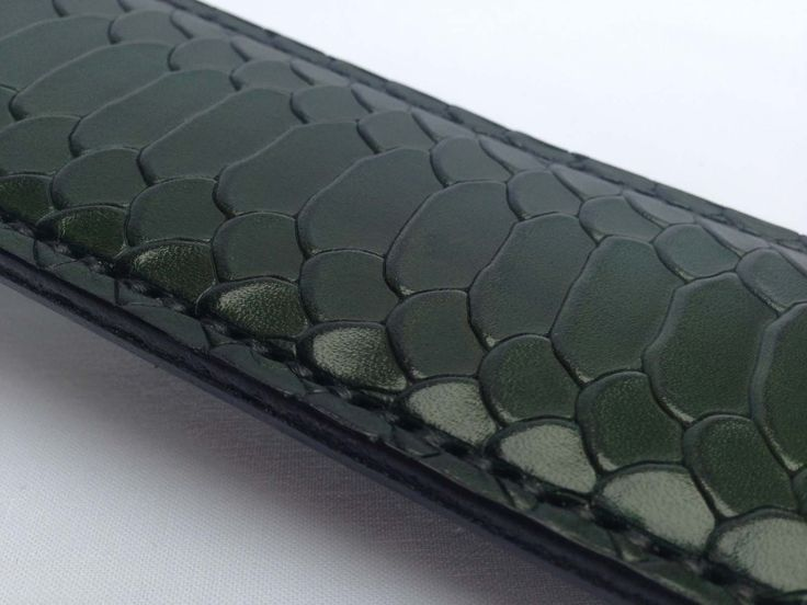 NEW - Dragon Series - Limited Edition - Paddles. Hand-made in Australia by us, from dragon patterned leather, from Belgium. Contains inner sprung core for strength and rigidity. Hand stitched handle detail. Emerald Green & Silver detail