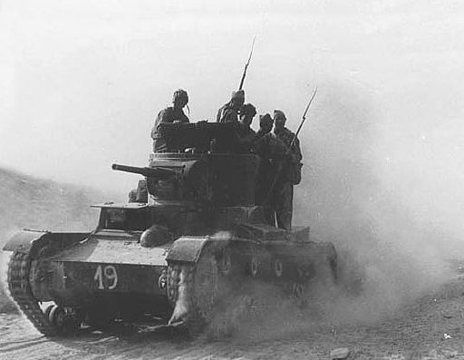 Spanish Civil War - Republican International Brigadiers at the Battle of Belchite ride on a T-26 tank