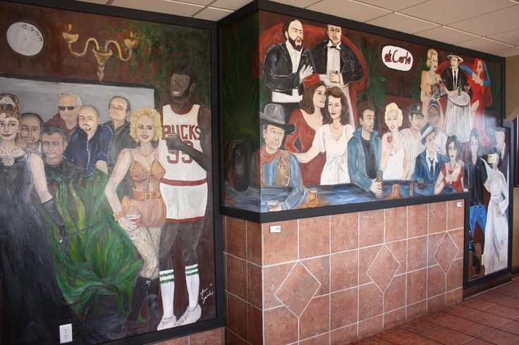 Di Carlo's (Wisconsin): Choices range from gourmet pizza to rustic bruschetta to filet ripieno (8 oz bleu cheese, portabella stuffed filet with vesuvio potatoes) and much much more.  Guess who's who on the mural while enjoying buon alimento (good food) con buoni amici (good friends). Buon Appetito!   .