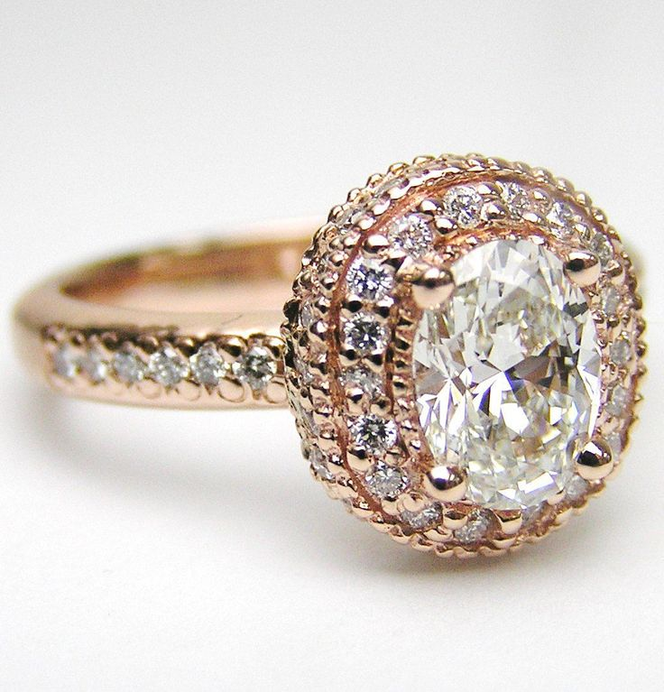 Oval Diamond Engagement Ring with double halo and diamond band in  Pink Gold 0.52 tcw.