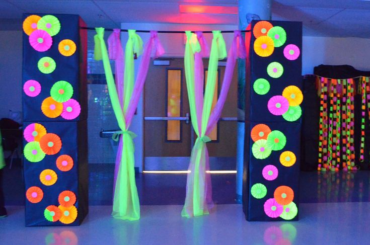 Door entrance made out of cardboard boxes, black paper, and fluorescent paper decor. UV Reactive light fabric from blacklight.com