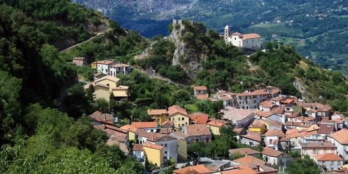"""A panoramic view of the upper section called """"rione superiore"""" including the castle of Ruggiero, placed over a steep cliff, and the sanctuary on the same rock."""