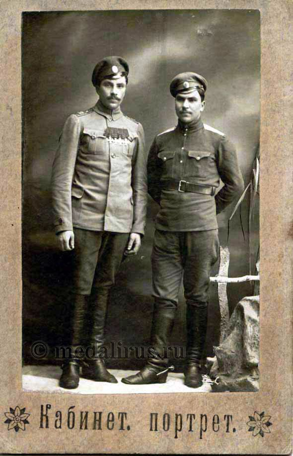 """Imperial Russian Army - Good comparative example of symmetric front button tunic with """"peasant shirt"""" style. Oval cockades on both service caps. Four Imperial Cross of Saint George Imperial Russian Medals on tunic on left. Classes of medal unknown. Ranks not visible from shoulder boards.  WW1."""