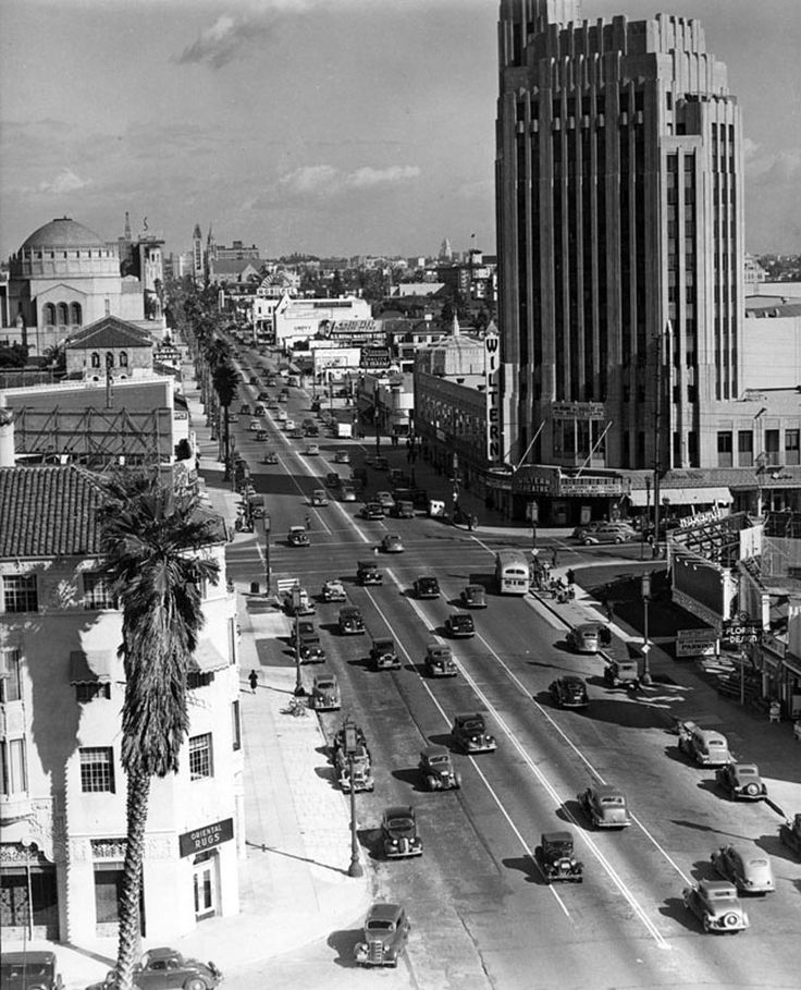 An epic view of Wilshire Boulevard looking eastward toward downtown. There are many recognizable buildings in the shot, including the Ambassador Hotel with its flagpole on top. The photo was probably taken mid to late 1930s, at a time when buildings were not allowed to be taller than the Los Angeles City Hall. (LAPL 00079561)  Bizarre Los Angeles