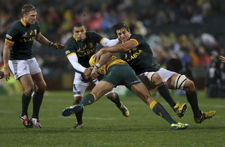 Eben Etzebeth (R) and Bryan Habana (2nd L) of South Africa's Springboks tackle Israel Folau (2nd R) of Australia's Wallabies during their Tri-Nations rugby union match at Subiaco Oval in Perth, Western Australia, September 6, 2014. (REUTERS)