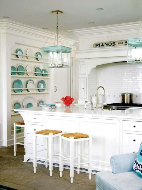 Great kitchen. Love the plate rack and those gorgeous turquoise lights!
