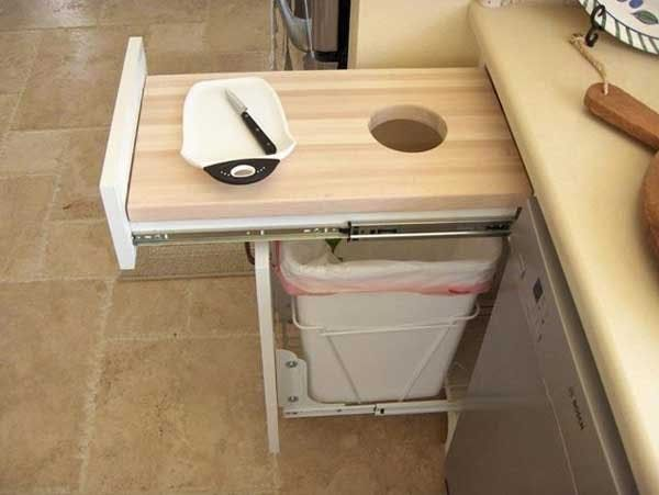This pull-out cutting board/trash can combo adds a little extra works space to a small kitchen, and makes sweeping scraps into the trash super easy. By Gary Wafford.