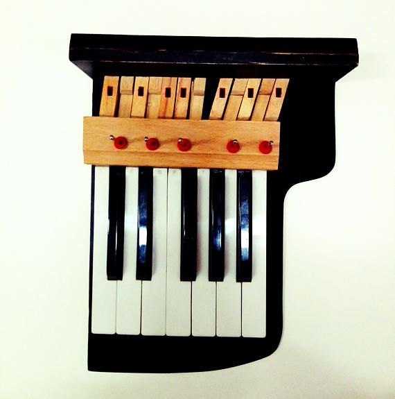 Check out this item in my Etsy shop https://www.etsy.com/listing/544250914/piano-key-keyholder-piano-key-holder