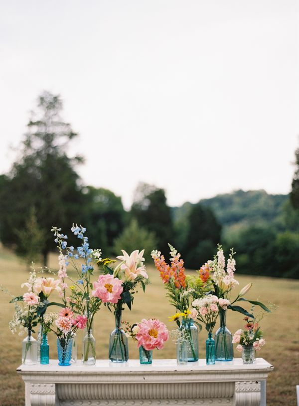 rustic florals in mismatched vases // photo by Tec Petaja, design + florals by Cedarwood Weddings // View more: http://ruffledblog.com/elegant-nashville-wedding/