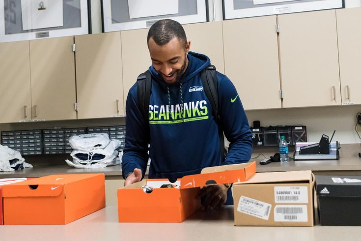 Seahawks players, coaches, and staff unbox the cleats and shoes they'll wear during the NFL's Week 13 campaign, 'My Cause, My Cleats,' which allows teams to support various causes important to them with uniquely designed footwear.