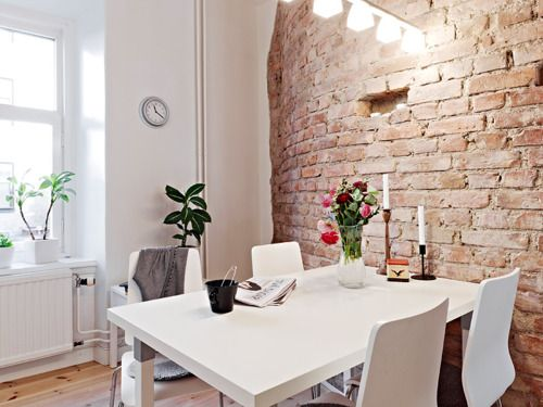 A brick wall is an attractive architectural feature in any home or apartment - Paint it, add decorative items or add a mantel creates warmth and depth to your wall. Have fun and be fearless!
