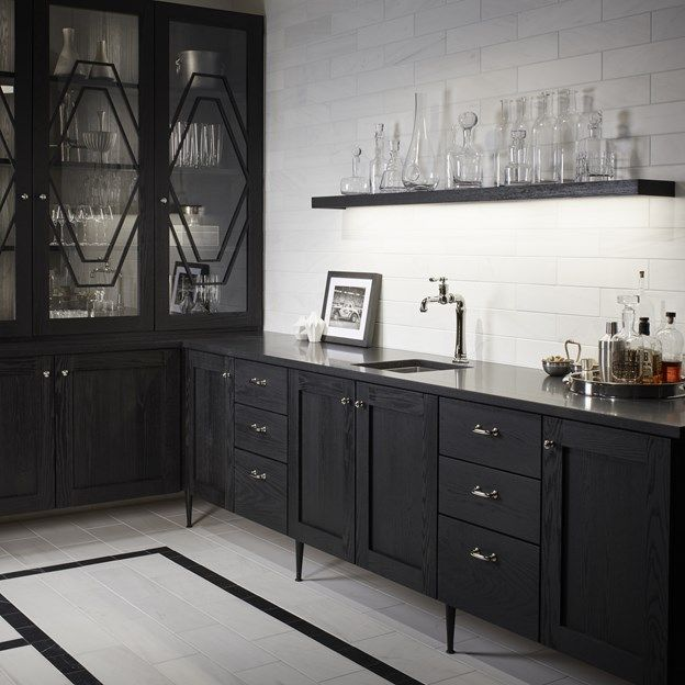 Dolomite Corina white marble subway tile with dark cabinets and marble kitchen floors.