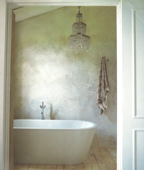 Beautiful bathroom with a chandelier and a massive bath!   Italian Country Living via Delight by Design