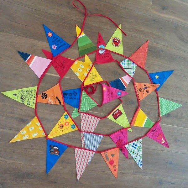 Met vlaggetjes gemaakt door kindjes.