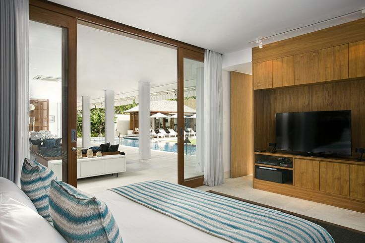 Villa Cendrawasih - bedroom or TV room http://prestigebalivillas.com/bali_villas/villa_cendrawasih/50/reservation_and_rate/