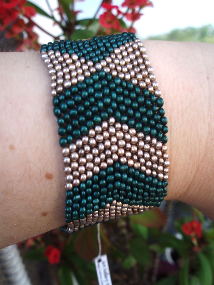https://www.etsy.com/listing/192647105/gold-and-green-metalic-bead-bracelet?ref=listing-shop-header-4
