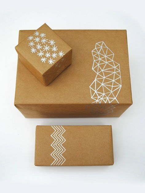 I adore the simple elegance of this hand-drawn gift wrap from Mini Eco. Using a silver paint pen to draw on brown packing paper looks great, and it would b