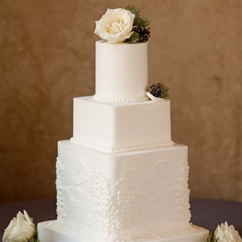 just love the simple white box cake in the middle... Just need some purple flowers.