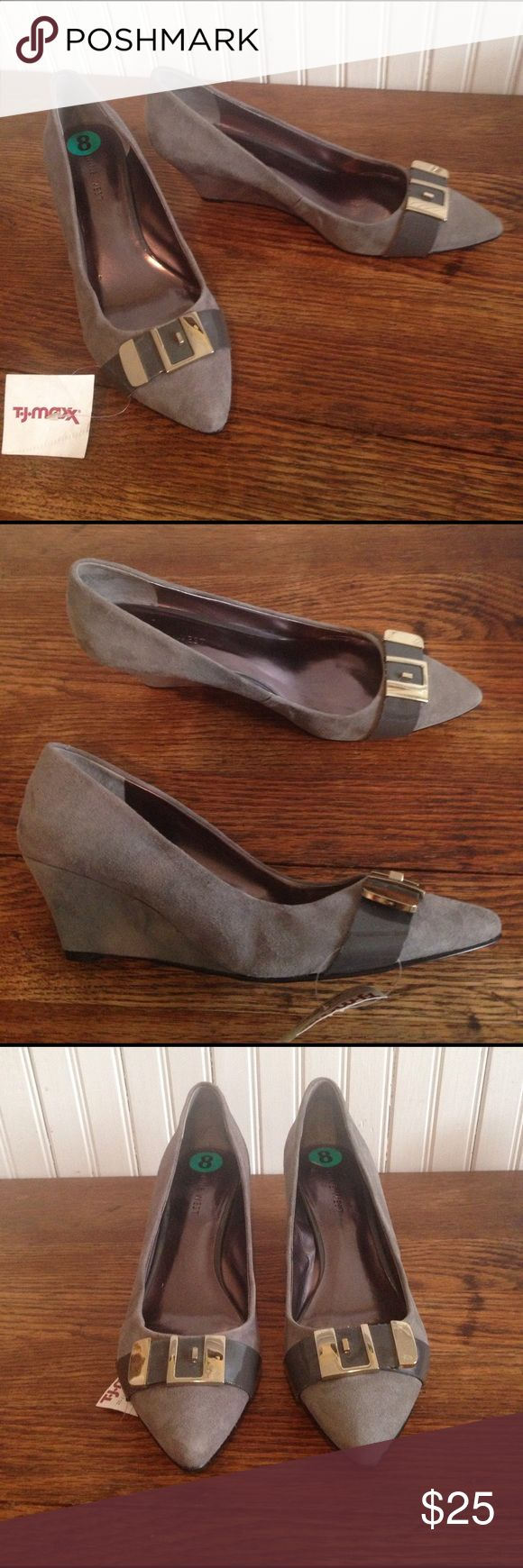 """NWT Nine West gray wedge heels size 8 NWT Nine West gray wedge heels size 8, leather and man made uppers , 2.5"""" wedge heels silver tone hard ware, New with tags but no box, great condition Nine West Shoes Wedges"""