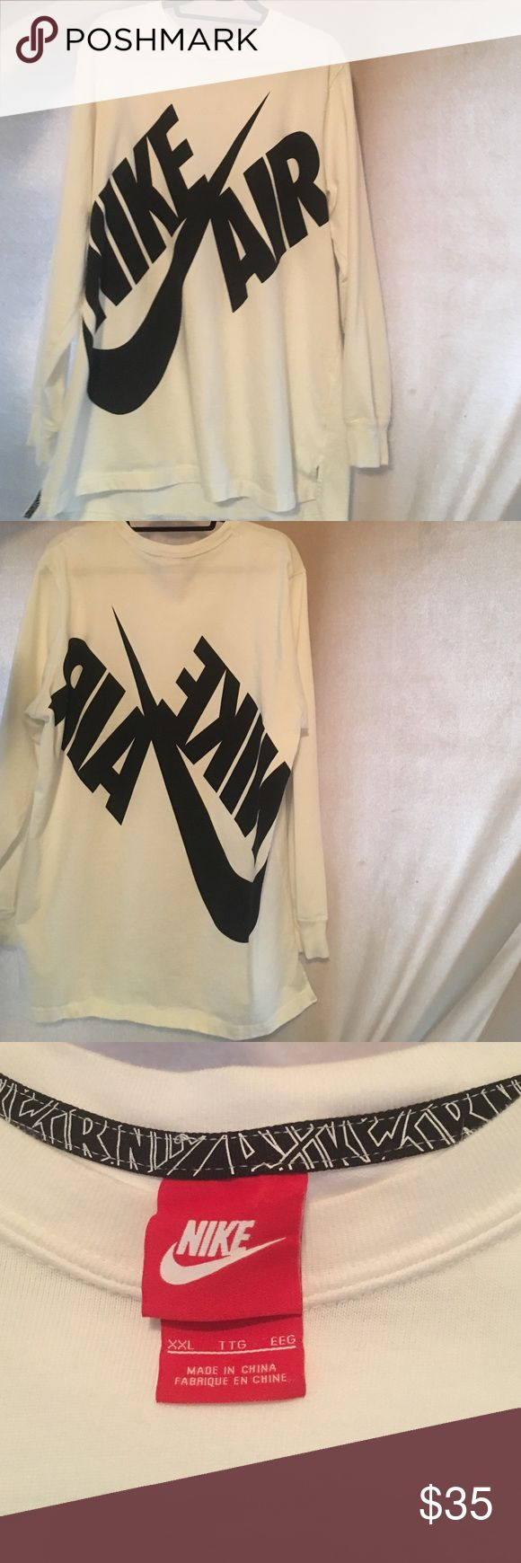Nike Air Long Sleeved T-shirt White with large Nike Air logo on front and back. Detailed border around collar and side slits. Cuffed arms. Like new condition, very clean Nike Shirts Tees - Long Sleeve