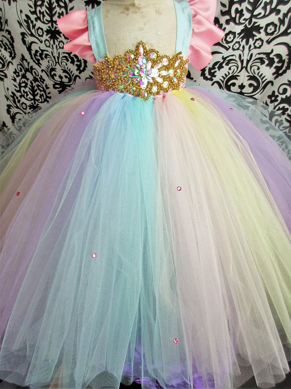 1d5f54d131e7 Sparkly and pretty, this Empire (high-waisted) waist tutu dress with  sleeves is bound to make any little girl feel like a unicorn fairy princess!