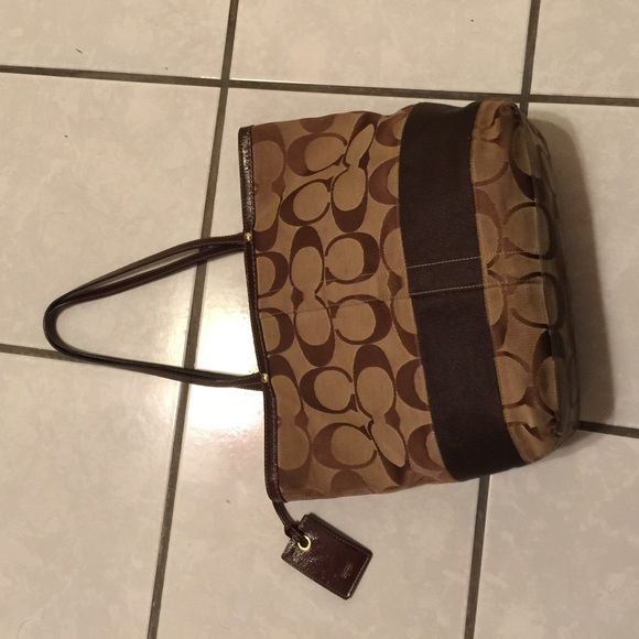 Coach Tote Purse Brown Tan Coach Tote purse needs bottom cleaned Coach Bags Totes