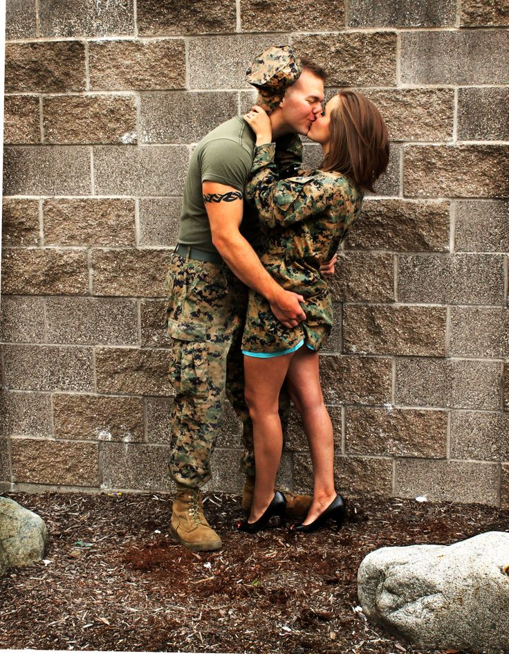 Marine and his girl. So cute! Love how the camo works well with the wall/ground.