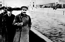 """Nikolai Yezhov walking with Stalin in the top photo from the mid 1930s. Following his execution in 1940, Yezhov was edited out of the photo by Soviet censors.[45] Yezhov became an """"unperson""""."""