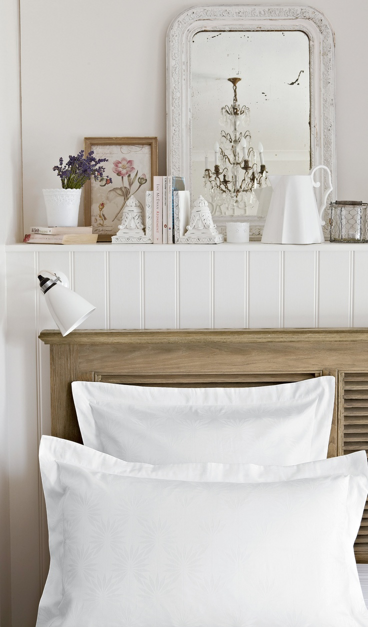 Style whites with rustic furniture for countryside chic.