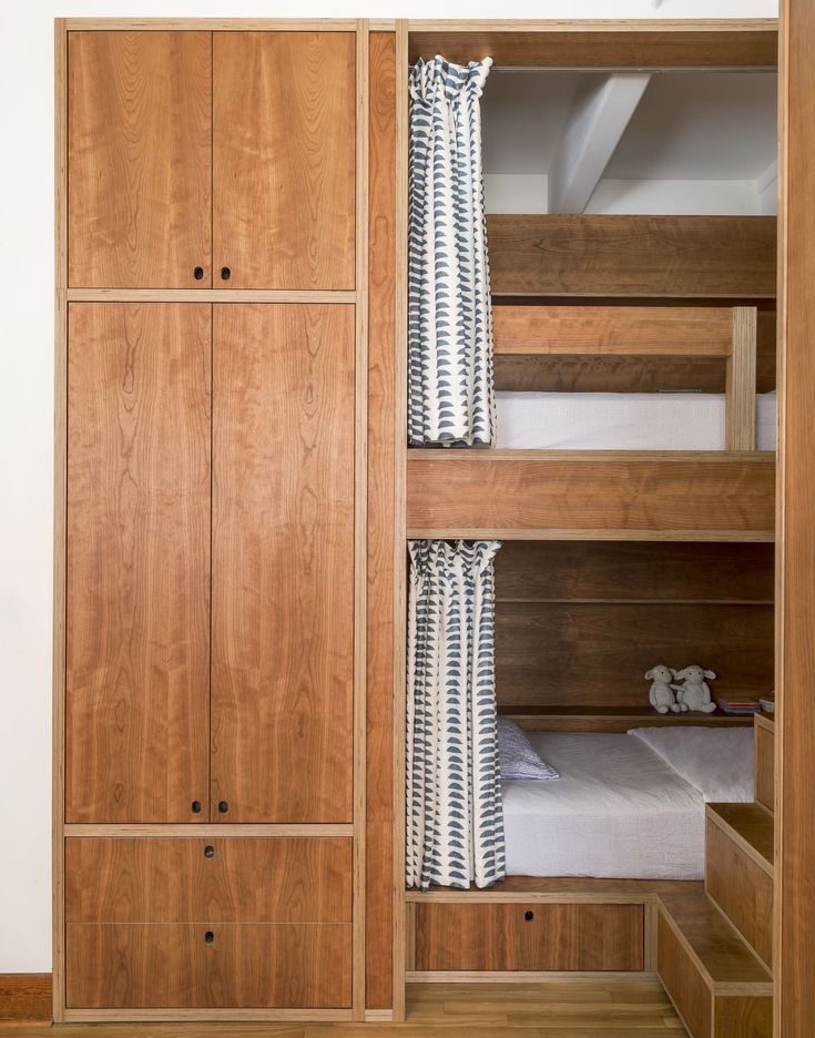 Kids' bedroom with custom built-in bunkbeds in cherry plywood with curtains   Workstead design, Matthew Williams Photo