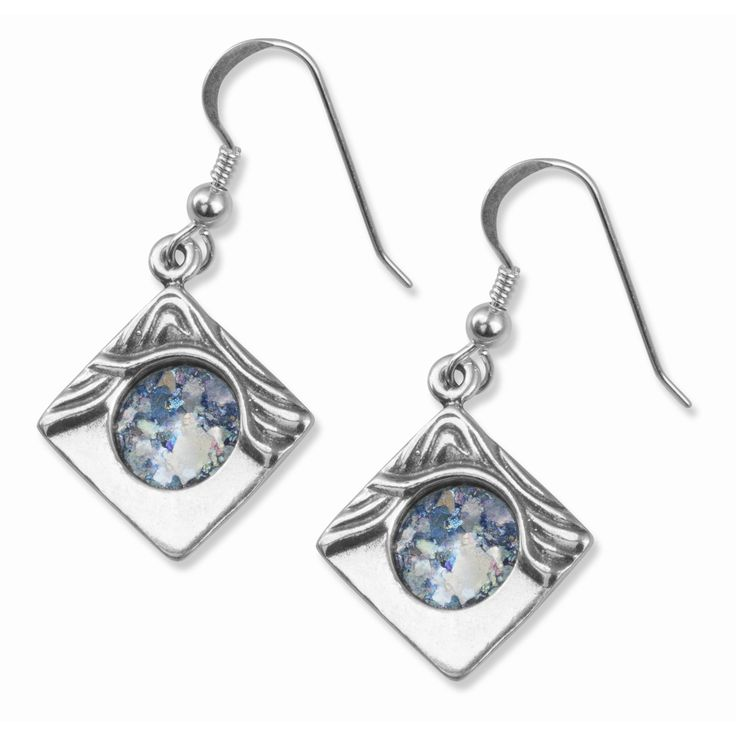 925 Sterling Silver, Roman Glass Size: 2cm x 2cm / 0.7 x 07 These unique square earrings feature a sparkling circle of iridescent Roman Glass held in a side-on square, surrounded by deeply etched wave