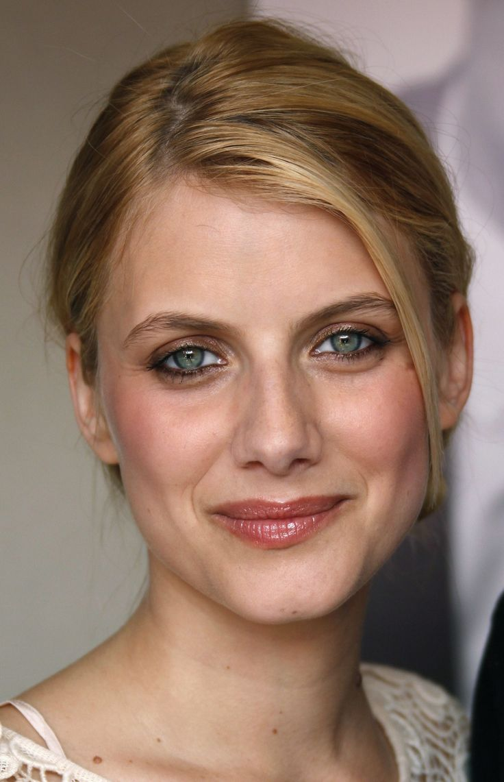 French actress Melanie Laurent | makeup | soft eyeliner | metallic brown eyeshadow | glossy lips