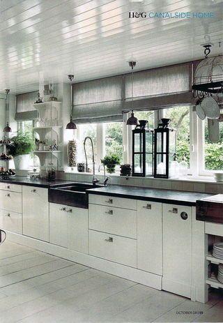 I like: the sink, the shades and the big black lanterns that bring out the color of the countertop