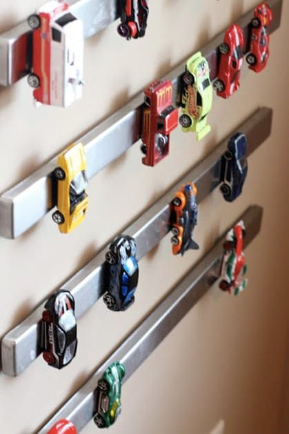 Cool detail for your tiny car lover's bedroom! | Creative Storage Solutions For Messy Kids' Toys via @PureWow