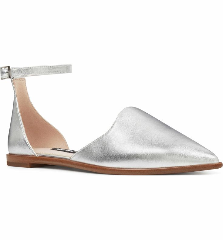 A pointy toe and a curvy d'Orsay profile add interest to a flat styled with a slender ankle strap.
