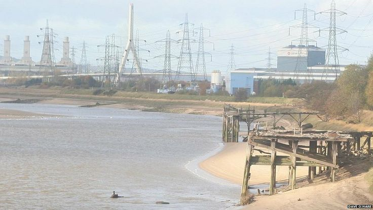 Old jetties can be seen on the Dee overlooking Flintshire Bridge - This present day photo shows some of the old wooden jetties on the opposite banks of Connah's Quay Dock Road