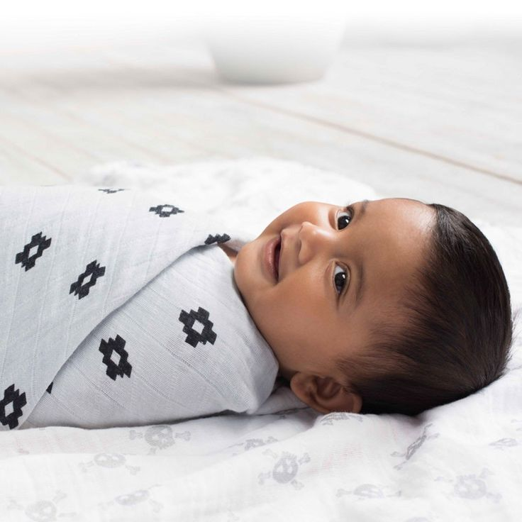 Four 120x120cm pre-washed 100% cotton muslin swaddles. Our extra large cotton muslin swaddles are as versatile as they are beautiful. By Aden + Anais