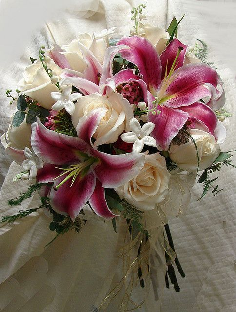 Stephanotis Rose and Stargazer Lily bouquet ♥️♥️♥️ this is gorgeous!! After roses...Stargazers are my fav!!!