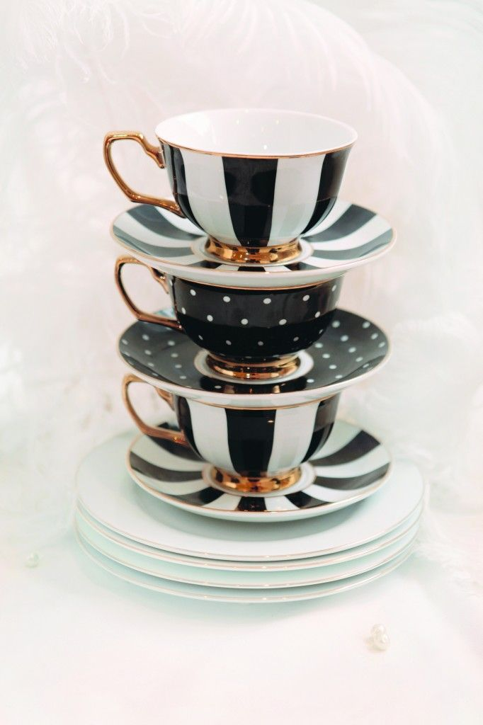 Designer Striped and Polka Black Teacups Stacked with Plates Portrait