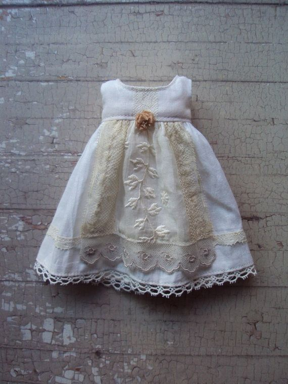 This dress is made from a lovely antique cotton. It has a delicate apron made with vintage lace, and lots of antique lace details. A simple but