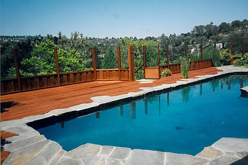 Natural Stone Coping And Wood Deck Swimming Pools