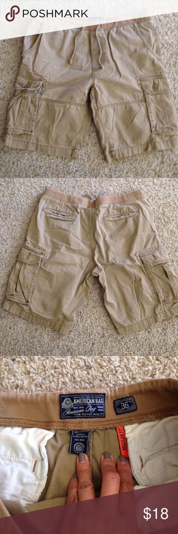 American Rag khaki cargo shorts Excellent condition men's American Rag cargo shorts. Tie waist. No holes or stains. Size 36 American Rag Shorts Cargo
