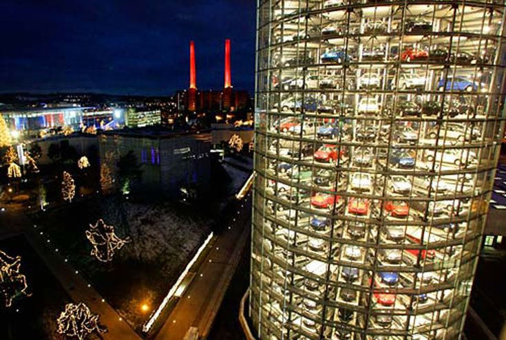 Location: Wolfsburg, Germany Background:  Volkswagen's Autostadt—an automotive-themed amusement park—includes a car museum, driving courses, car-factory tours and these 20-story car silos. Why It's Unique: European VW buyers can opt to pick up their cars from the robotic car silo instead of the dealership—the automation ensures they will receive a car with an odometer that reads zero. After spending a day enjoying the park, customers watch the central robotic arm travel up the tower and ...