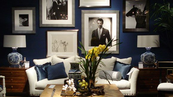 Classic look navy walls with black white photos and metal accents