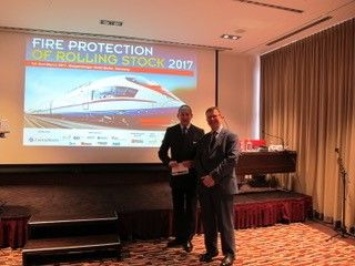 #FlashbackFriday to our CEO at Fire Protection Rolling Stock Conference in Berlin 2017 discussing fire safety on trains. With thanks to Tony Cash from the Rail Industry Fire Association. #RIFA #FPRS #Berlin #FireProtectionforRollingStock #passengersafety