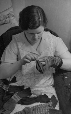 1930's vintage photo, woman darning a sock. My granny taught me how to do this, using a darning egg.