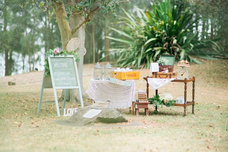 A hydration station for that outdoor wedding ceremony is a must. Styling, props and florals by The Vintage Way