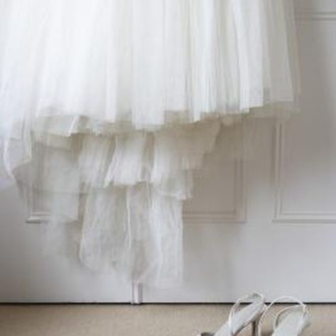 A detachable wedding skirt adds drama to a short wedding dress.